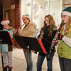 Alysha Freehafer, Maggie Zink, Mackenzie Connelly and Rosalie Osberg from the Ballston Spa School District play holiday tunes before the annual Ballston Spa Holiday Parade Friday. Photo By Eric Jenks