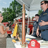 Judith Sweet learns about the Round Lake Fire Department's history from firefighter Mike Frasl during the Round Lake Craft Fair