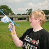 Josh Busold sights a rocket at Ballston Spa Middle school