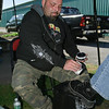 Ryan Michaels of Badass Leather Cream polishes up a customers boot. Photo By Eric Jenks