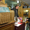 Brent Millington talks with Michelene Diggins Thursday in his store.