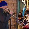 Ballston Spa High School Junior Jeff Carminati plays some holiday tunes for the gathered crowd while waiting for the Holiday Parade to begin friday night in Ballston Spa. Photo By Eric Jenks 12/3/10