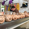 From Rochester, NY Coco Bongs owner Todd Englert sits with handmade Monkey head cups/coin banks during the Round Lake Craft Show.