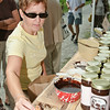 Michele Bourgeois samples a delicious product from Sundae's Best Hot Fudge Sauce at the Round Lake Craft Fair
