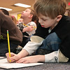 Andrew Eisle works on a drawing of American Eagle during Author George O'Connor's visit to Wood Rd Elementary Tuesday.