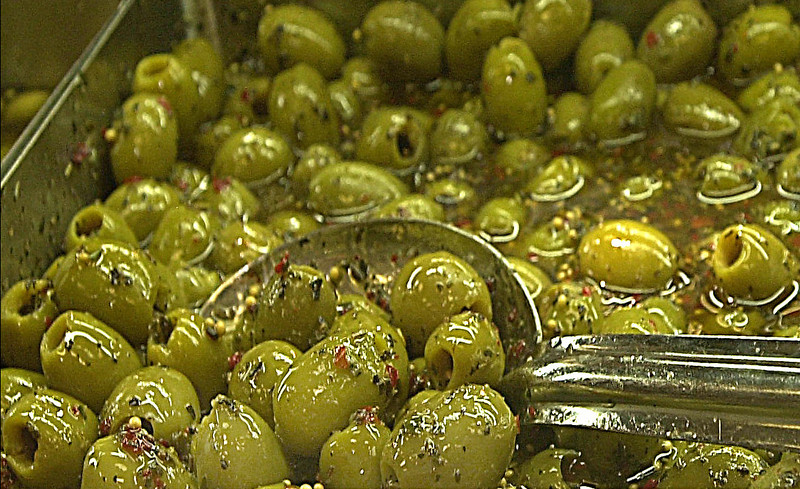 (090107): ACT_RocheBrosOliveBar-- Enjoy the Mediterranean Blend of green olives infused with zesty herbs from the Divina Brand at the Antipasto bar inside Roche Brothers Super Market; Acton, Ma. .SUN/Amanda-Beth Potter..DIG IM/3174