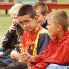 (091507):BED_NativeAmericanPowWow-- 10 year-old Nikolas Dube, (Center), of Dracut, takes his attention away from events at the 25th annual Native American Pow Wow, sponsored by G.L.I.C.A. Nikolas is part Cherokee, Huron, and Erie. DIG IM No.3275...SUN Photo by Amanda-Beth Potter