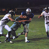 JosŽ Quezada/For the Times-Standard<br /> <br /> No. 35 Fortuna on a 30+ yard gain to the Warrior two-yard line.