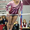 Olivia Matthews keeps her eyes on the bars Sunday afternoon at the YMCA.