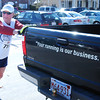 "(030908):LOW_HynesRoadRace---Mark Coddair of Chelmsford stretches, prior to the start of '08 Hynes Tavern 5K Road Race;  against his company truck, MarxRunning & Fitness Ctr. (marxrunning.com) which states ""Your Running is Our Business"" across the back of the Ford pick up...DIG IM No.04058. SUN Photos by Amanda-Beth Potter"