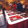 111710:   Lowell HS Hall of Fame Indiction : DRA_LHS Hall of Fame induction, Thursday night at Lenzi's..Sydney Nelson, 3, grand-daughter of  inductee Walter Nelson checks out awards. Sun Photo Bob Whitaker_DIG#1974