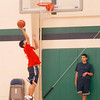 (2008)-12/14-------LowCath_BoysBBpreview---- 17-year-old, Sophmore, Terarith Thay makes a lay-up during practice in the  Lowell Catholic High School gymnasium ........... DIG.IM#2486---SUN/ Amanda-Beth Potter