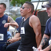 052310 :Lowell FireFighters Road Race  :  LOW_. Lowell Firefighter racers post finish, from l. Mike Dexter Jr., with Josue Rodriguez, and Nathan Kilbride, r. relax pn ladder truck after running in Lowell FF race. Sun Photo Bob Whitaker_DIG #839