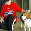 (050408)-2008_0504_TYG_AnimalRescue--- 9-year-old Ryan Johnson of Chelmsford meets Taylor an 8-year-old Beagle who is eager to be adopted through Lowell Humane Society's animal adoption day at Best Friends Pet Care Center in Tyngsboro..  DIG IM No.0865..SUN/Amanda-Beth Potter