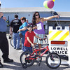 091709: Lowell Police Bike Rodeo : LOW_.  Lowell Aux. Police Officer Henry Dozois, l. at check point with Matthew Paula,8, and mother Fabiana Paula of Lowell at the Lowell VFW for bike rodeo.  Sun Photo Bob Whitaker_DIG#1837