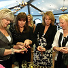 Joanne Martinez, Roberta Feiden, Maggie Quinn and Debbie Smigen look at rings from Rockabella during the Fashion show at the Saratoga National Golf Course Sunday Afternoon. The show was held for the Saratoga Previontion Council's benefit. Photo Eric Jenks, 4/18/10