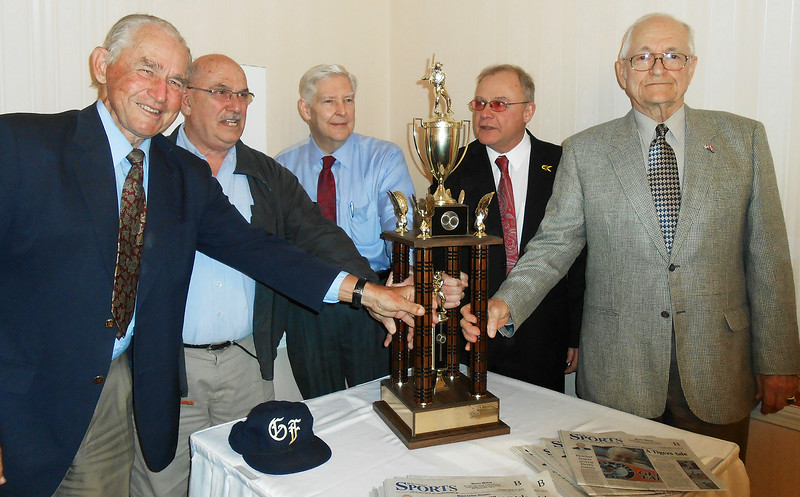 Cutline: Former Glens Falls Tigers owners Richard Stanley, left, and Frank Schafer, right, presented their team's 1988 regular season championship tropy to Glens Falls city officials on Thursday at the Queensbury Hotel. Joining them are, left to right, Public Works chief Robert Schiavoni, former Mayor Ed Bartholomew and current Mayor Jack Diamond. (Paul Post photo)