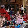 Cindy Ellen of the Milton Eagles Women's Auxillary reads to children on her float Friday night during the Ballston Spa Parade. Photo Eric Jenks 12/4/09