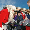 Santa has a chat with Justin Ronarrigo while brother Dominick and mother Meghan look on. Photo Eric Jenks 12/5/09