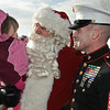 First Sargent Edward Ackley of the Marine Corps takes a moment to spend some time with his daughter Gabriela and Santa at the Saratoga Train Station Sunday Morning. Photo Eric Jenks 12/5/09