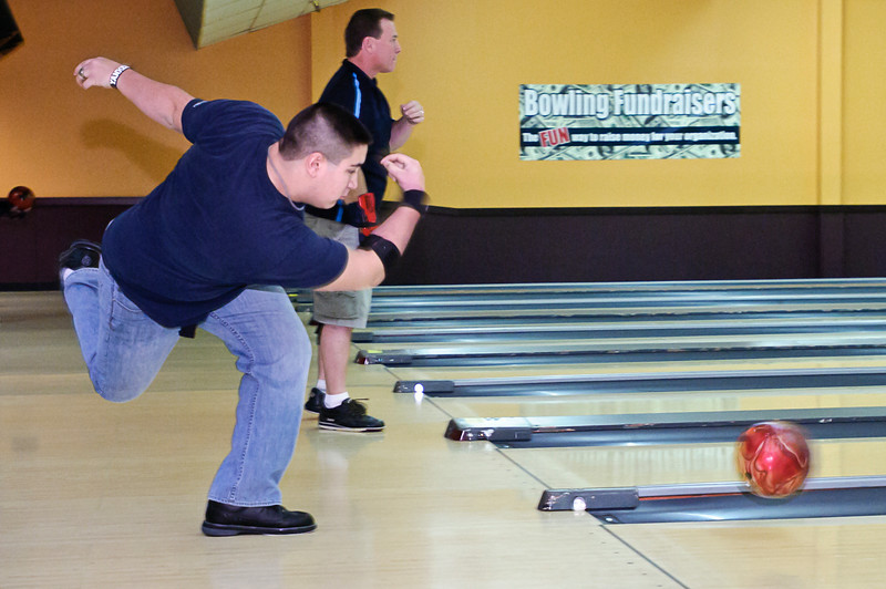 Andrew Lloyd from Saratoga trys out a bowling ball during the demo day at Saratoga Strike Zone Sunday morning. Bowlers get to try out the latest and greatest from Ebonite international. Photo By Eric Jenks 12/12/10