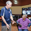 Tom Laskow of Ebonite International has a talk about bowling balls with Dolly Newman from Albany Sunday at the Saratoga Strike Zone Demo Day. Photo By Eric Jenks 12/12/10