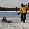 Walter Sass gives his son Walter Junior a ride on the ice at Lake Desolation after the outhouse races Sunday Afternoon. Photo Eric Jenks