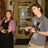 "Zak Young and Barbara ""Babs"" Pyndus perform on the street on Broadway in Saratoga Springs Saturday night. Photo By Eric Jenks"
