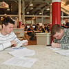 Ryan Yingling and Dustin Greer fill out paper work during the NYRA Job Fair Sunday Morning at the Race course in Saratoga Springs. Photo Eric Jenks 6/13/10