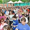 Hundreds of runners fill SPAC during the Rock and Run 5k Sunday Morning. Photo By Eric Jenks 5/22/11