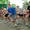 Runners jump off the starting line during the Rock and Run 5k held at SPAC for the second year. Photo By Eric Jenks 5/22/11