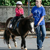 Katie Henry goes for a ride with Breanna Flint of Dream Ponies Sunday afternoon during the Fall Festival. Photo Eric Jenks 11/1/09