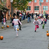 Children fly down Caroline Street during the pumkin race at the Fall Festival Sunday Afternoon. Photo Eric Jenks 11/1/09