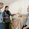 Alex Goldberg and Catia Ojeda look at the samplings offered by Robin Ryan aof Fine Affairs Sunday afternoon during the First Annual Bridal Show at the National Dance Museum in Saratoga. Photo Eric Jenks 11/8/09