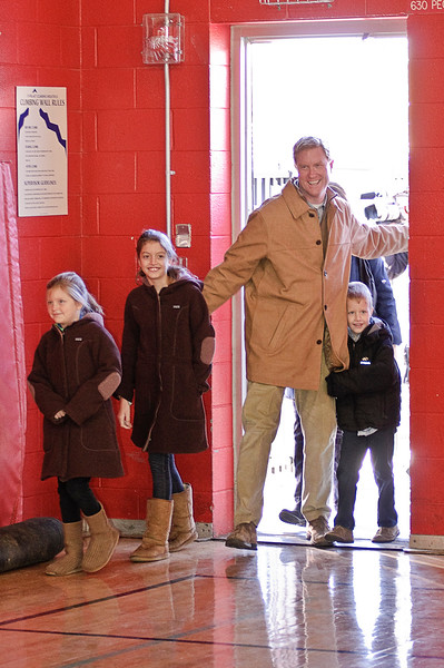 Scott Murphy walks into the Glens Falls Highschool Tuesday morning with his family to vote. Photo By Eric Jenks 11/2/10