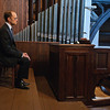 David Hyde Pierce waits next to the newly renovated George and Laura Pierce Memorial organ during the dedication service and public recital at the Bethesda Episcopal Church in Saratoga Springs Sunday afternoon. Photo Eric Jenks 10/11/09
