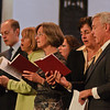 David Hyde Pierce (Far Left) sings with the other members of his family at the Bethesda Episcopal church Sunday during the dedication service and public recital of the newly renovated organ. Photo Eric Jenks 10/11/09