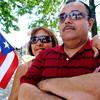 (071308)--2008_0713_2008_071308_PR_Festival----- Ias and Hector Velazquez of Lowell watch as the Puerto Rican Flag is risen at the steps of Lowell's City hall where community members gathered to celebrate the spirit and culture of Puerto Rico... Sunday July 13th- SUMMER'08.----  DIG IMNo.1460.. SUN/Amanda-Beth Potter