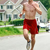 Shawn Donegan with a time of 17:29 took home first place during the Fairways 5k in Wilton Saturday. Photo Eric Jenks 5/22/10