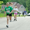 Caroline Burns leads the way during the children's portion of the Fairways  5k