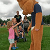 Kaitlin Joy goes for a high five from the Star 101.3 bear