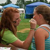 Victoria Bimenna gets her face painted by Jenna Eddy