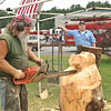 Jim Petrillo of Earthworks makes a wooden bear with his chainsaw during Parkfest