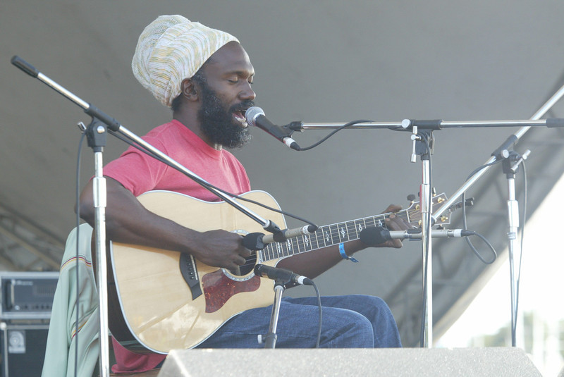 Shaun Walker/The Times-Standard<br /> <br /> Correy Harris plays his acoustic blues music on Saturday.