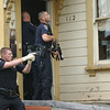 Mark McKenna/The Times-Standard<br /> Eureka Police Officer Alan Aubchon holds his gun drawn while Officer Gary Whitmer enters a house during  a search for Jay Xanadu Eddington. He was fleeing officers when he entered a house on Del Norte Street in Eureka across from the Senior Center.