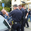 Mark McKenna/The Times-Standard<br /> Officers escort a handcuffed and shackled Jay Xanadu Eddington shortly after detaining him. He was fleeing officers when he entered a house on Del Norte Street in Eureka across from the Senior Center.