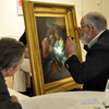 JosŽ Quezada/For the Times-Standard<br /> <br /> Bruce Pettit of Heritage Antiques and Coins uses a flashlight to get a close look at a third generation oil painting bought in Europe by the grandfather of David Aronovici, far left. Pettit suggested that Aronovici send a photo image to Sotheby's for their assessment of the 18th century painting.<br /> <br /> Heirlooms, treasures, antique art and other valuable collectables were brought to the Morris Graves Museum of Art to have their value assessed at the Appraisal Faire, held in the room next to the unique Collectors' Sale held in the rotunda room.