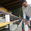"Josh Jackson/The Times-Standard<br /> <br /> Kurt Medeiros helps set up the luminaria in the granstands that spell out the word ""HOPE""  during the 2007 Relay for Life at College of the Redwoods on Friday."