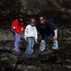 Mark McKenna/The Times-Standard<br /> Mia Tonkin, left, Corrine Seghetti and her father Tony look for sea life in the tide-pools at Trinidad State Beach on Friday. The students were on a field trip with the entire first grade class of Ridgewood Elementary School.