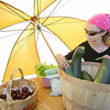 Shaun Walker/The Times-Standard<br /> <br /> Belle Snow, 11, tends to produce from Al and Carolin Petrovich's Rio Dell farm at the Rio Dell Farmers Market on Wednesday. The market is open on Wednesdays from 3 to 6 p.m. next to the Chamber of Commerce on Wildwood Avenue.